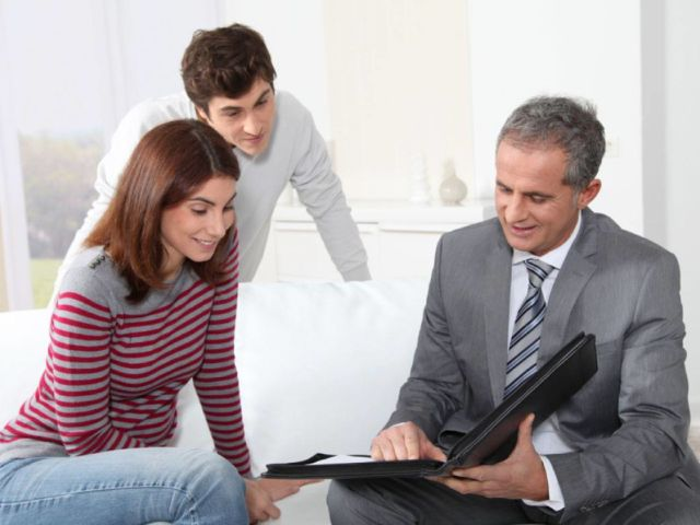 Young couple working with a financial advisor